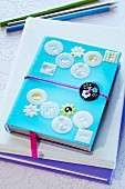 Notebook decorated with buttons