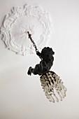 Pendant lamp with glass beads and cherub figurine