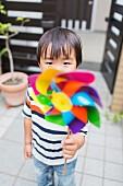 Little boy with a pinwheel