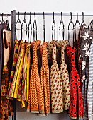 Colourful collection of dresses on clothes rack