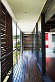 Balcony with sliding sunshade panels and long glass wall