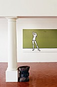 Unfurnished interior with modern painting on wall and wooden artwork next to classical column