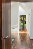 Top storey of architect-designed house with landing, parquet floor and view into garden