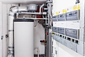 Close-up of boiler in domestic technology room with various installations