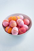 Bowl of dyed Easter eggs wrapped with yarn