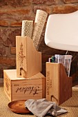DIY box files upcycled from old wine crates and classic rocking chair by Eames against rustic stone wall