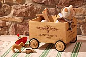 Wine crate on rollers for toy storage in front of rustic stone wall
