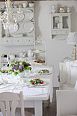 Set table in white dining room
