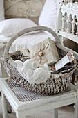 Vintage sewing utensils in wicker basket on old chair