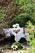 Table set with cake in garden