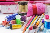 Still life assortment of hobby craft, knitting, painting, drawing and sewing accessories