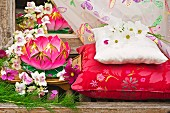 Waterlily shaped paper Chinese lantern with Orchids and cushions outside
