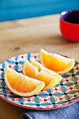 Wedges of lemon on colourful ceramic plate