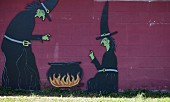 A Halloween Cut Out on a Wall of Witches with a Cauldron