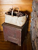 Pinecones are stored in a handmade basket made from birch tree bark