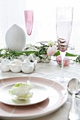Easter place setting with egg-shaped candle and champagne flute