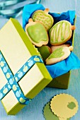 Apple-shaped biscuits in gift box with ribbon