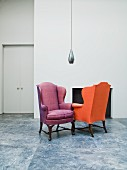 Lobby with two colorful upholstered armchairs and modern hanging light
