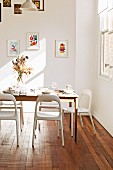 Light falls into the simple dining room with wooden floor