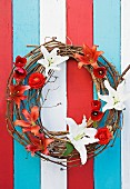 Door wreath hand-crafted from twigs, lilies, tulips & ranunculus