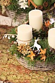Rustic Advent arrangement with four candles in wicker basket