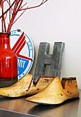 Vintage wooden shoe lasts and ornamental letter