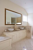 Vanity unit with two countertops and Buddha figure, framed wall mirror in the bathroom