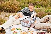 A couple having a picnic on a heath