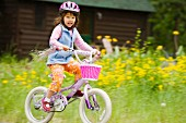 Portrait of girl riding bike