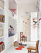 Radiant, white child's room with built in bunk beds, wall shelving and vintage chairs