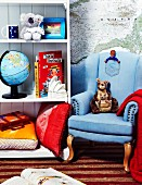 Child's room decorated with an armchair, shelves and Australian themed decorations