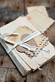 Old book and letters tied up with lace ribbon