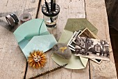 Embossed envelopes, pebble as paper weight, dip pens and old postcards