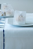 Hand-wrapped gift on festive place setting