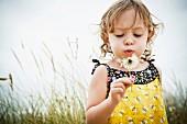 Little girl with dandelion clock