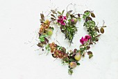 Heart made from autumnal flowers, leaves & fruits