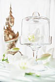 White lilies and Oriental statue decorating table