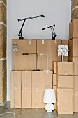 Various lamps & stacked packing cases