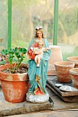 Madonna figurine in greenhouse