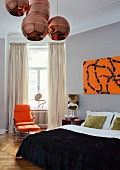 Copper Shade pendant lamps in artistic, retro bedroom with modern artwork above elegant double bed