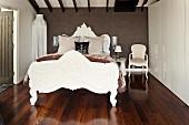 Majestic, postmodern double bed, white floor-to-ceiling wardrobe and dark, exotic wood parquet floor in bedroom