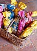 Basket of hand-sewn, silk lavender bags
