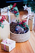 Christmas presents decorated with twigs of berries