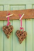Wicker hearts on green wooden door