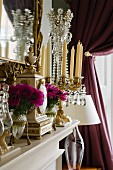 Magnificent arrangement of crystal candelabra and classic mantel clock on mantelpiece