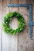 Wreath of myrtle and box on barn door