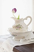Purple tulip in ceramic pitcher and bowl set