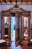 Antique, mirrored wardrobe with secret door