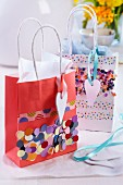 Gift bags decorated with confetti and washi tape