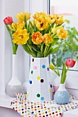 Tulips in vase decorated with felt confetti
